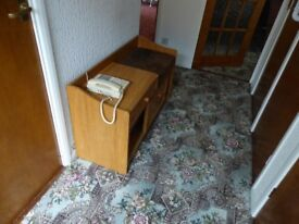A telephone seat with drawer and cupboard
