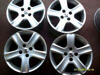 Peugeot alloys decent condition