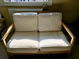 small, modern 2 seater sofa with wood frame and washable covers
