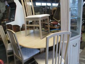 extendable table and 4 chairs and corner unit. lovely set and modern look