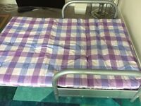 Metal Framed Sofa Bed With A Purple Mattress