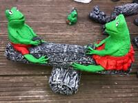Frogs on seesaw garden ornament