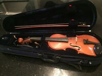 1/2 sized violin with case for sale.