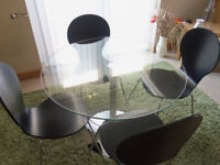 Glass and chrome table with four chairs
