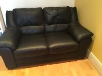 2 Seater black faux leather in good condition. 156x83cms. Buyer to collect