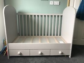 Grey IKEA cot bed with drawers