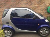 Faulty and slightly battered Smart for sale for parts. The car runs.