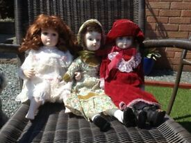 3 Collectible dolls with pottery faces and limbs