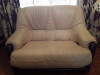 2 seater creem leather sofa.unmarked and very comfy.ideel for conservatory or space filler.