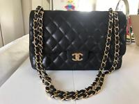 Black big chanel bag with golden chain classic