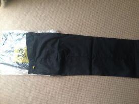 Genuine JCB workwear. Trousers in black 30 waist. 2 pairs brand new unworn