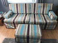 Large solid sofa and foot stool