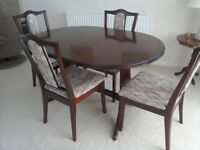 An Oval Nathan Mahogany Extending Dining Table and 4 x Chairs in excellent condition.