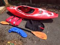 1 X dagger GTX Kayak with buoyancy aid, paddle, and splash deck