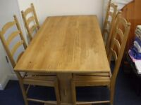 WOODEN TRESTLE STYLE TABLE AND 4 CHAIRS