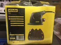 Sander - Electric, Mini, Palm McKeller 105 Watt Sander. Unused Still in sealed packaging. Brilliant!