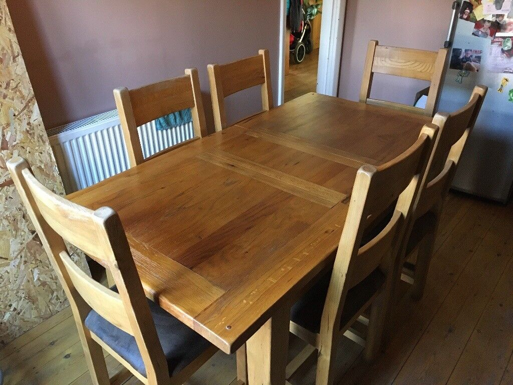 Solid oak dining room table and 6 chairs