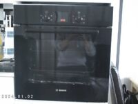 Electric Oven with black glass door by BOSCH