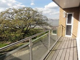 Modern 2 bed, 2 bath, 2 balcony apartment, direct river views, reserved parking