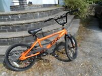 zinc 20 inch wheel orange bmx bike