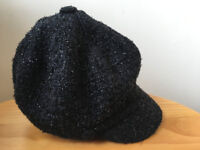 Marks & Spencer (M&S) women's black, sparkley, peaked hat. One size. Black/bright pink spot lining.