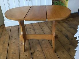 Small wooden fold down table