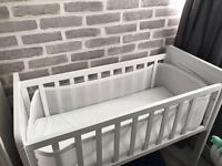 White mother care crib