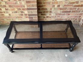 Black wood and rattan coffee table with glass top