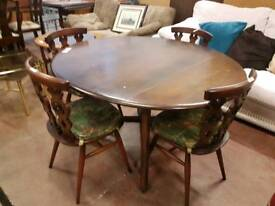 Ercol dark wood dropleaf table and four chairs