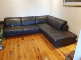 Large DFS chestnut brown, real leather corner sofa.