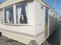CHEAP STATIC CARAVAN FOR SALE/on the beach/unreal location/quiet/facilities/low ground rent