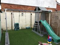 Wooden climbing frame slide and swings