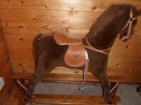 Mamas and Papas rocking horse on wooden frame. Used but in good condition.