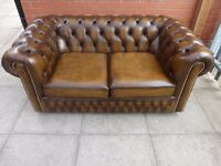 A Tanny brown leather chesterfield two seater sofa