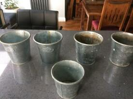 Five lovely metal plant pots