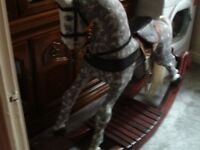 Rocking horse. Large. Hand carved complete with leather saddle and reins etc. Excellent condition.