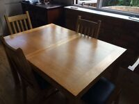 Extending Solid wood dining table and four chairs
