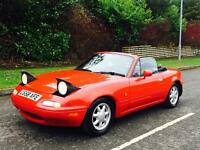 1990 MAZDA MX5. CLASSIC INSURANCE. THIS IS A FUN CAR TO DRIVE.