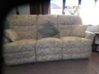 3 seater settee. Both outside seats are manual recliners. Made by Vale Bridgecraft