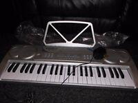 49 key multi-function electronic keyboard. Boxed.