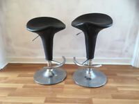Matching bar stools, well-loved, leather covers