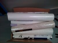 Large box of appx 17 rolls of wallpaper brand new - ask if you just one some