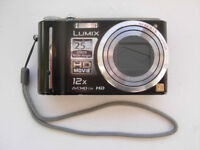 Panasonic Lumix DMC-TZ7; 2 batteries; Leica lens; 10.1MP; 12x Optical Zoom; Ultra-wide angle; HD
