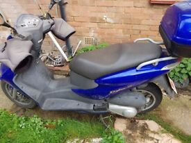 Good running bike. 2 previous owners. Mint condition Blue scooter with blue top box.