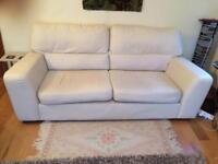 Cream leather settee. £40