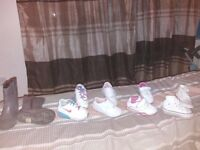Girls shoes ranging from pram shoes to infant size 5