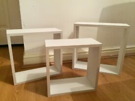 3 white cube shelves