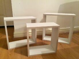 3 white cube shelves