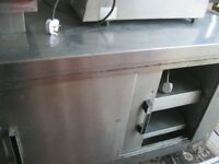 COMMERCIAL STAINLESS STEEL WORKING SURFACE DOUBLE SIDED HEATED CABINET.GOOD ORDER.VIEW/DELIVERY POSS