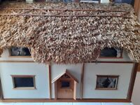 Dolls house. Thatched roof.